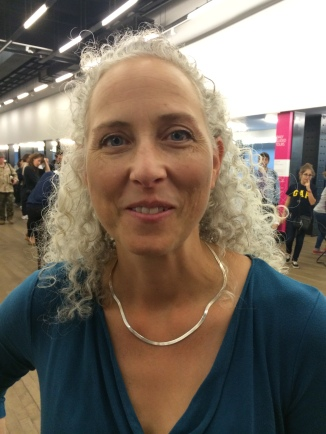 Woman with naturally curly grey hair