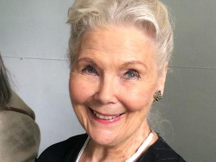 Elegant older woman with white hair